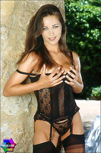 Kyla Cole - Black Corset & Rattan Chair